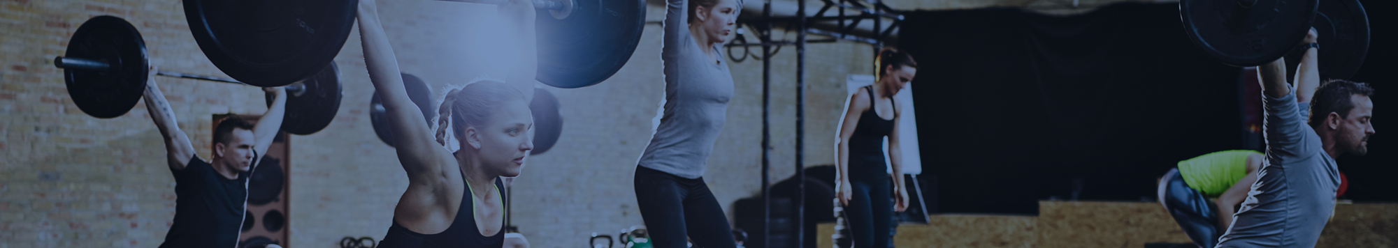 Gym class, woman lifting weights